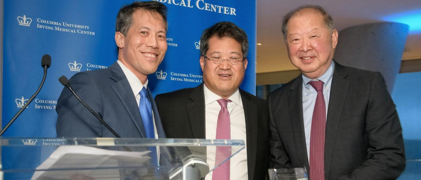 David Wu, MD, and Roger Wu, MD, awarded Stanley Chang, MD, the Dr. Clyde and Helen Wu Award for International Understanding at the 2018 Symposium