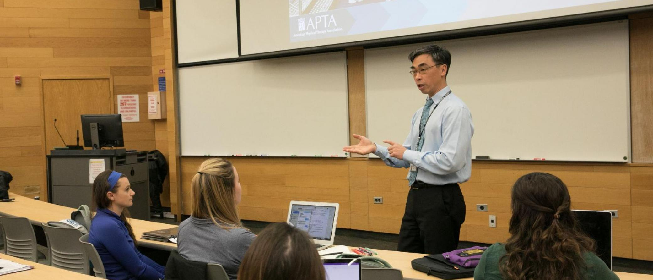 Dr. Kevin Wong lecturing to students